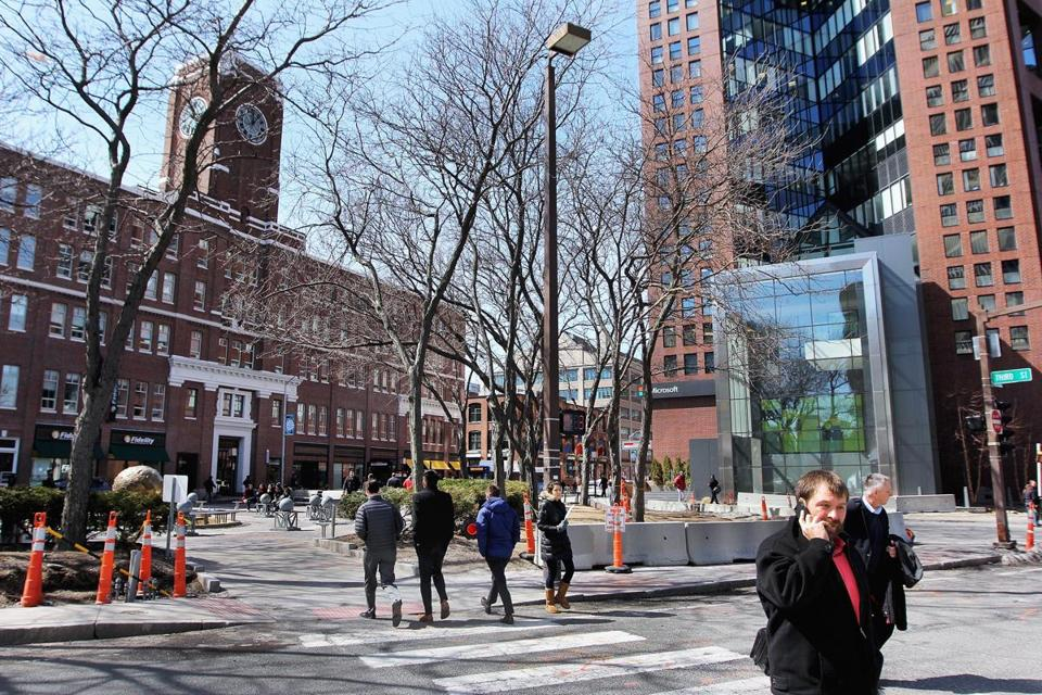 The university envisions a bustling business district, reminiscent of Kendall Square (above), at the site.