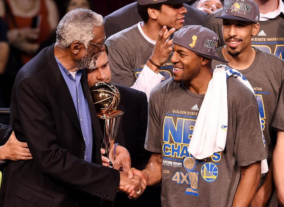 Bill Russell awards Andre Iguodala with the Finals MVP trophy, named after Russell.