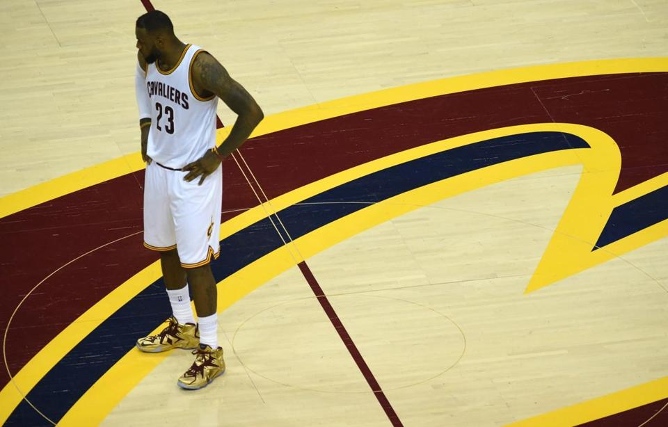 LeBron James stands at center court during Game 6.