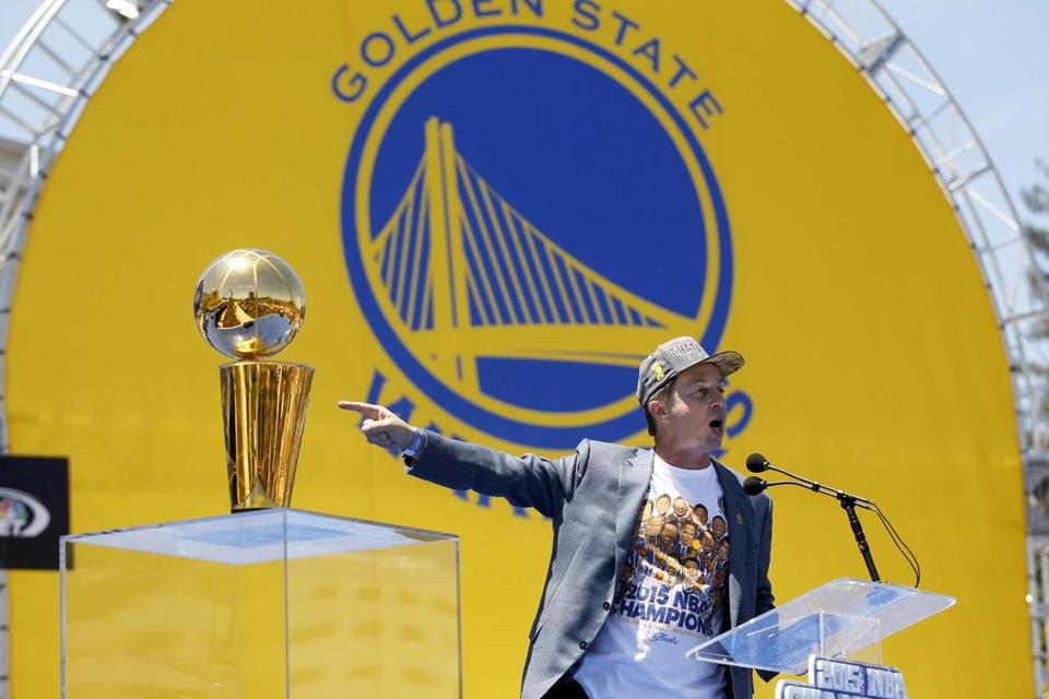 Warriors co-executive chairman and CEO Joe Lacob pointed toward the Larry O'Brien Championship Trophy during the team's celebration in downtown Oakland.