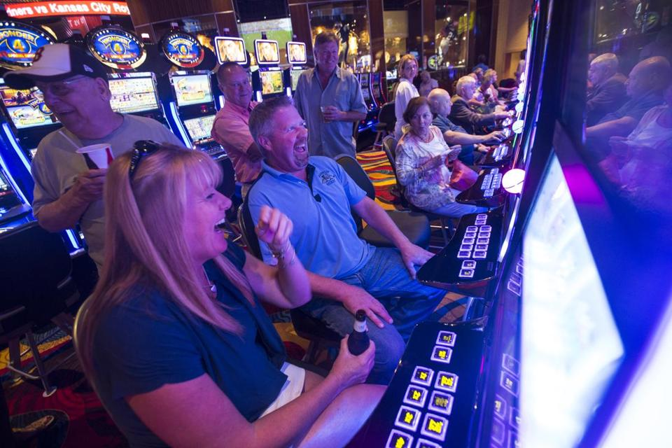 Judy Nunn and Charlie Robinson celebrated as Robinson won at a slot machine at the Plainridge Park Casino on Monday.