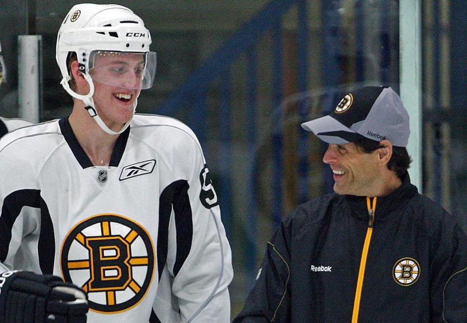 The Bruins didn't sense Dougie Hamilton (left) wanted to stay in Boston long term, so Don Sweeney (right) shipped the young defenseman to Calgary.