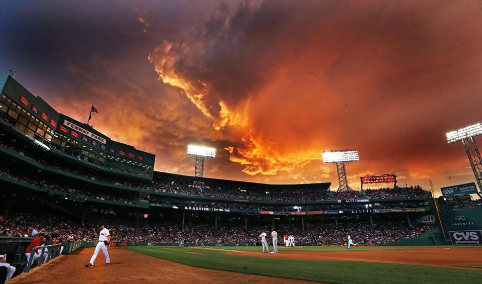photo essay mother nature and fenway park the boston globe storm clouds provided a colorful and appropriate backdrop during a game on 23