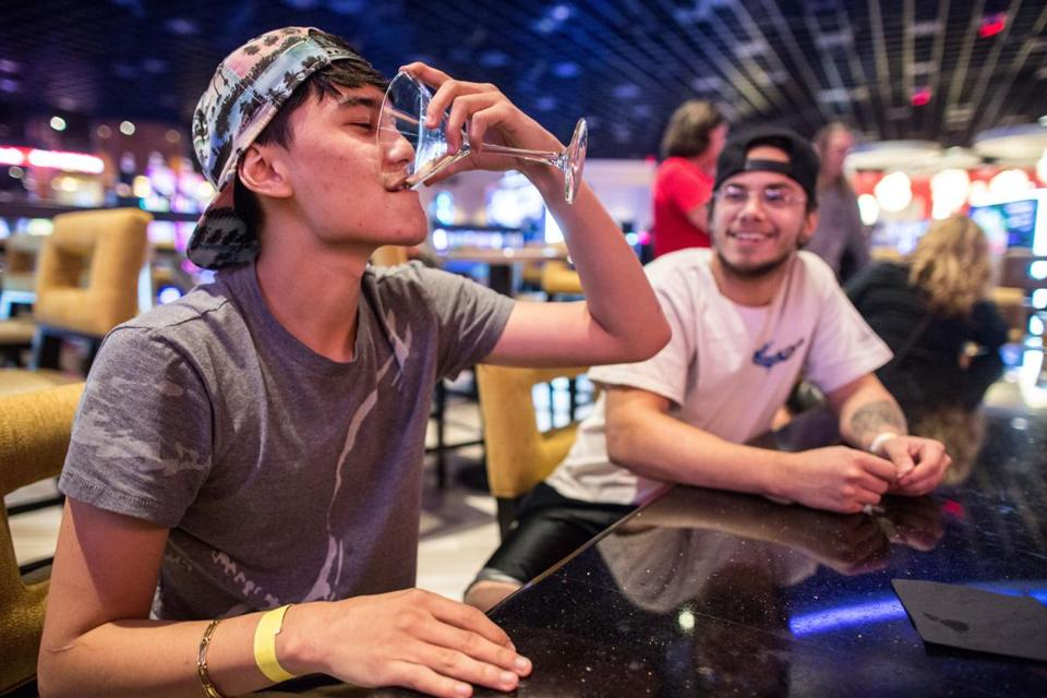 Lucas Yosimura, 21, (left) of Franklin, quickly finishes his drink as last call is announced.