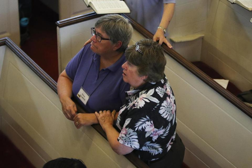 Marcia Hams (right) and Susan Shepard, who have been married for 11 years, were the first gay couple in the country to receive a legal license to wed. They attended services Sunday at First Parish Church in Cambridge.