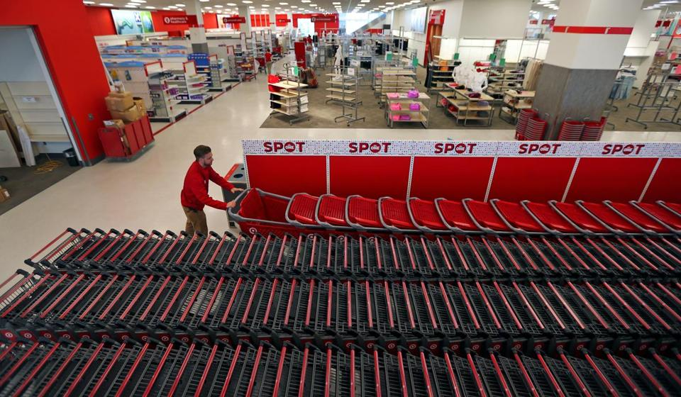 A CityTarget employee arranges shopping carts inside the new store.