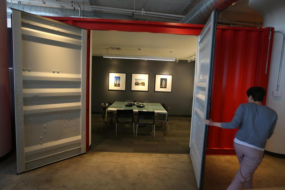 Heavy metal doors give away the origin of this meeting room, which was  assembled at