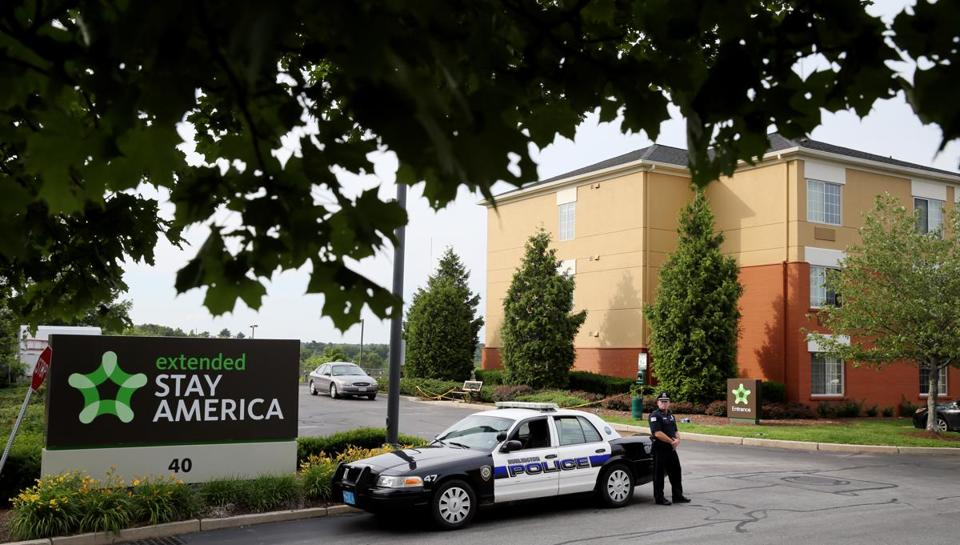 A Burlington police officer stood earlier this month at the entrance of the Extended Stay America hotel, where the body of Sanisha Johnson was found.