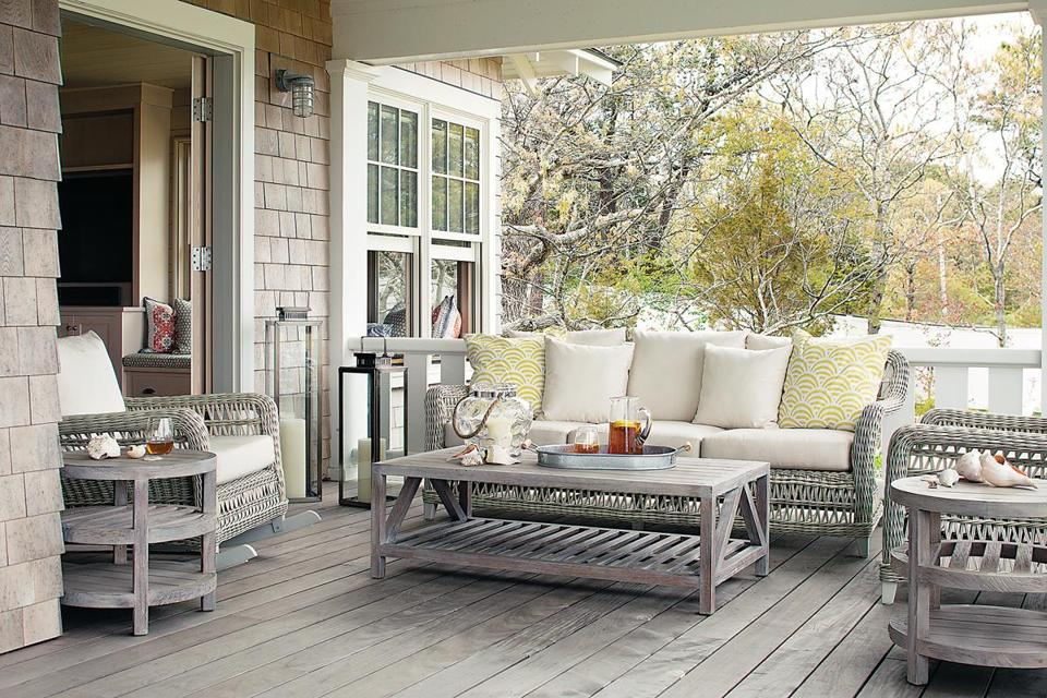 The seating and tables on the porch are from Janus et Cie.