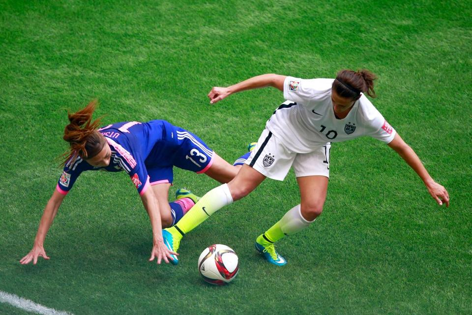 Carli Lloyd (right), who was named the tournament's best player,  battled Japan's Rumi Utsugi for possession during the Women's World Cup final.