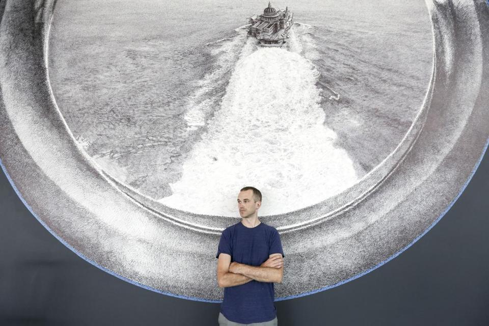 "Ethan Murrow at the ICA in front of his wall mural, ""Seastead."""