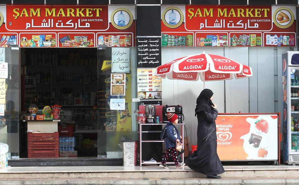 A woman and a child left a Syrian shop in Mersin in March.