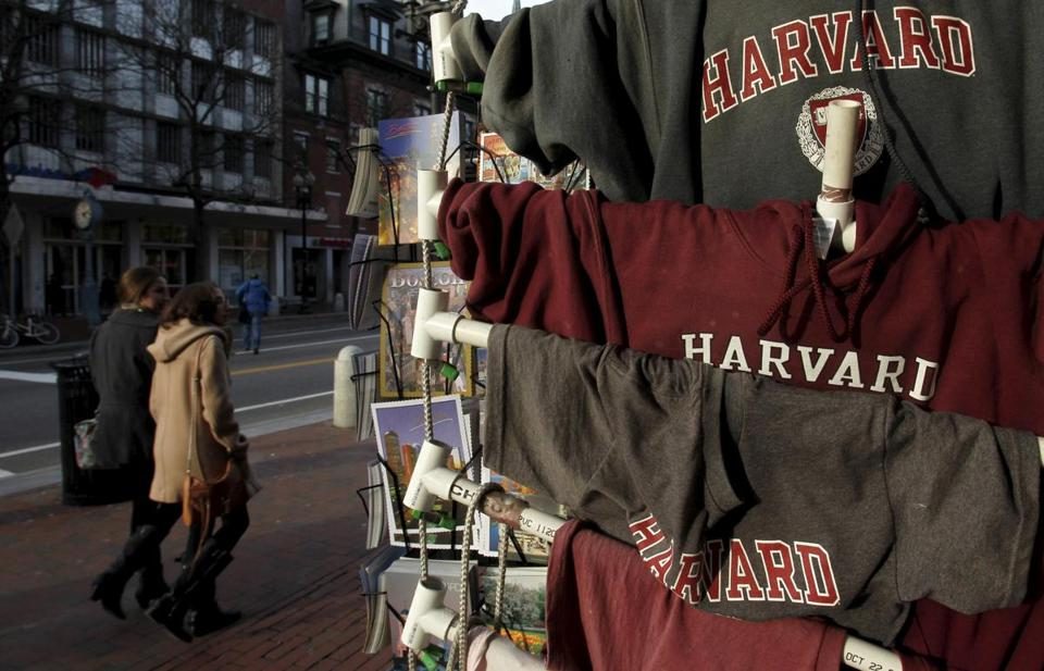 People walk past Harvard University t-shirts for sale in Harvard Square in Cambridge, Massachusetts in this November 16, 2012 file photo. To match Special Report USA-HARVARD/DISCRIMINATION REUTERS/Jessica Rinaldi/Files