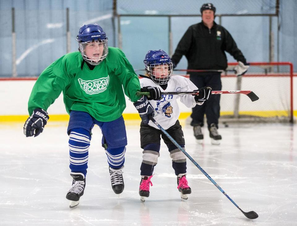 06/18/2015 HINGHAM, MA L-R Will Lacey (cq), sister Catherine, 6, and his dad Patrick Lacey (cq), skate at Pilgrim Skating Arena (cq) in Hingham. (Aram Boghosian for The Boston Globe)
