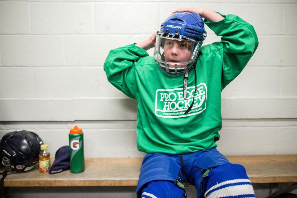 06/18/2015 HINGHAM, MA Will Lacey (cq) puts on a helmet before skating at Pilgrim Skating Arena (cq) in Hingham. (Aram Boghosian for The Boston Globe)
