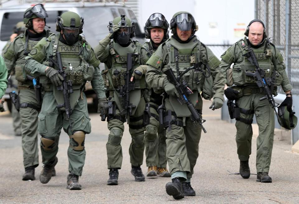 Members of a SWAT unit arrived at a Cambridge location in 2014 to participate in training.