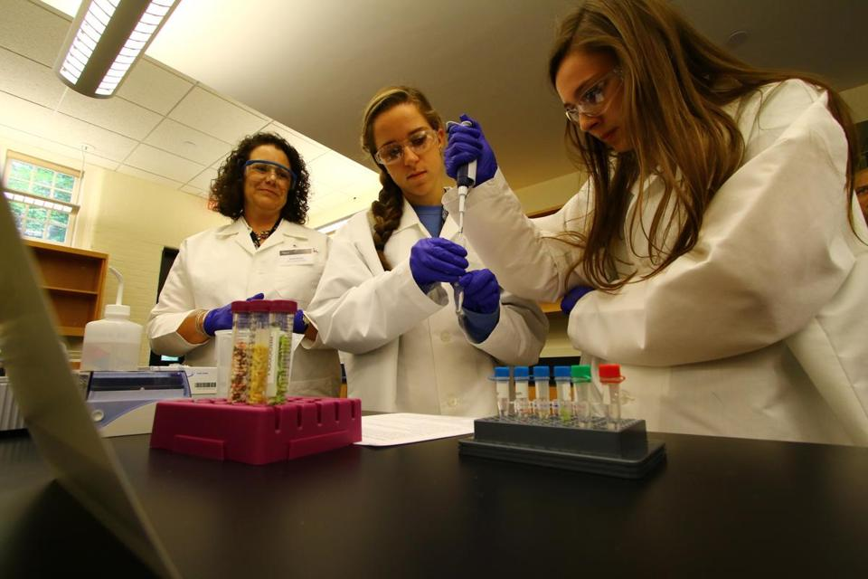 Dr. Nicole Nichols of New England BioLabs watched Archbishop Williams students Jaclyn Shuttleworth and Sarah Golden.