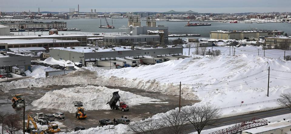 BOSTON, MA : THE PAST......2/10/2015: Boston's snow farm keeps getting bigger seen here by the Seaport District in South Boston. With more snow present hitting close to records, Boston area just deal with it..... (David L Ryan/Globe Staff Photo) SECTION: METRO TOPIC stand aone