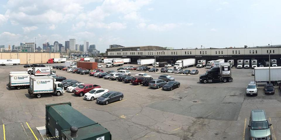 A wide-angle view of operations along Foodmart Road, which bisects the Widett Circle complex of meat and seafood wholesalers being eyed as a stadium site by Boston 2024 organizers.