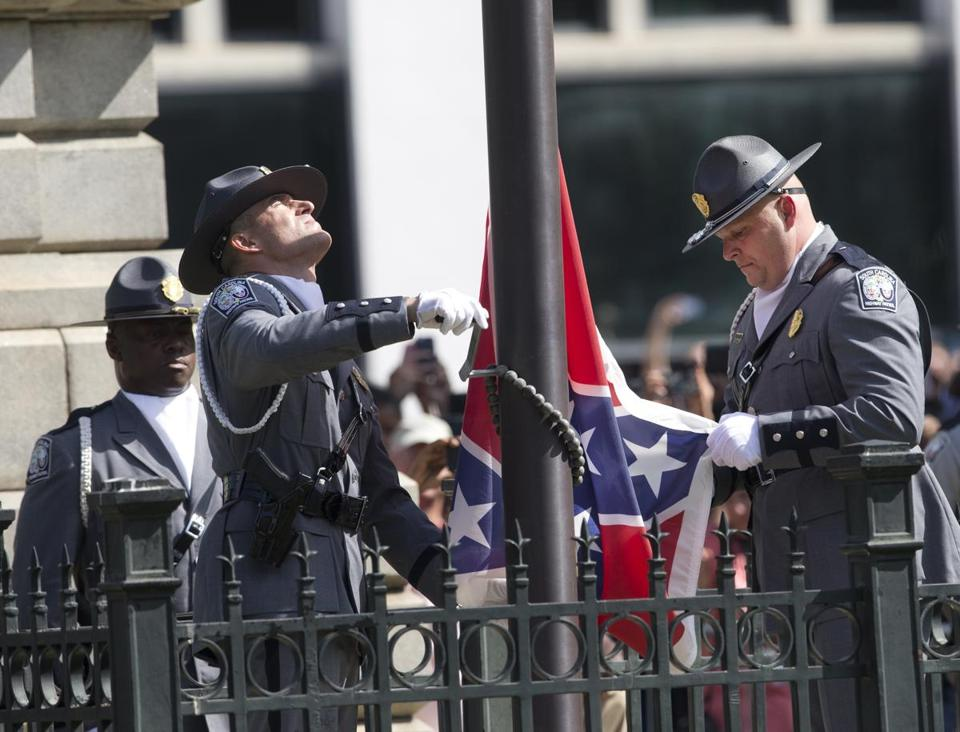 The flag was lowered by an honor guard of South Carolina troopers during a 6-minute ceremony.