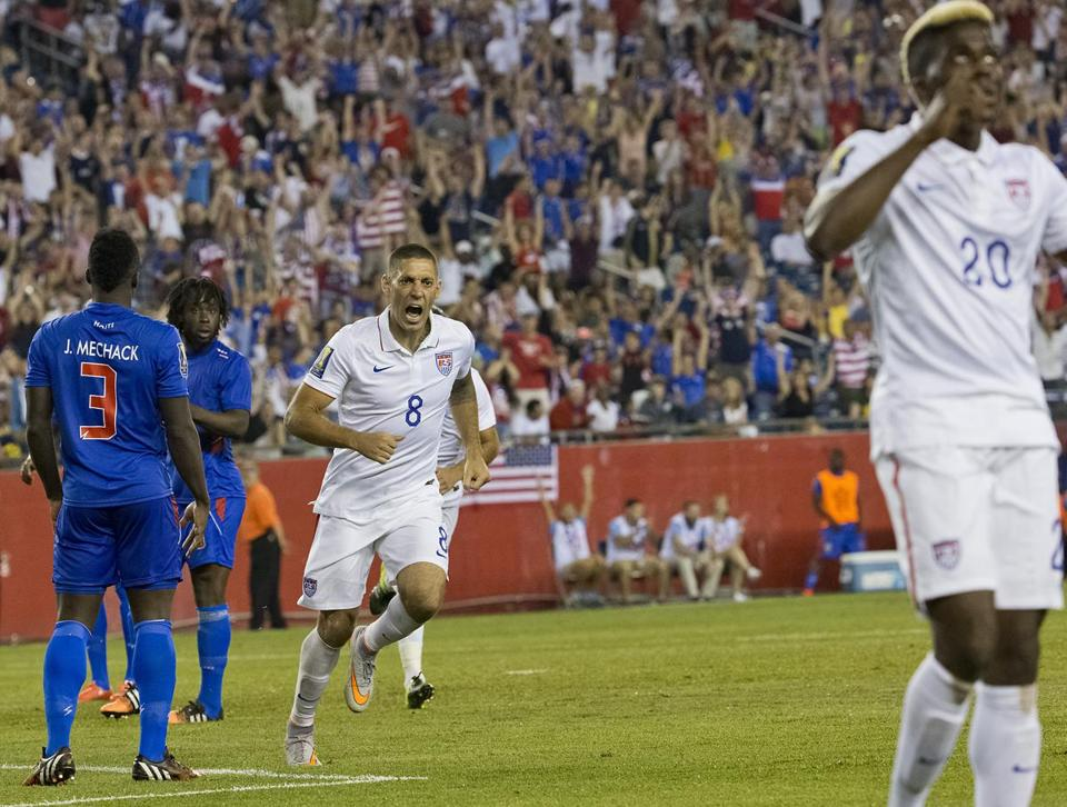 Foxborough MA 7/10/15 USA Clint Dempsey runs towards his teammate Gyasi Zardes who assisted him on the first goal fo the game agaisnt Haiti during second half action at Gillette Stadium on Friday July 10, 2015. (Matthew J. Lee/Globe staff) Topic: US-Haiti soccer Reporter: John Powers