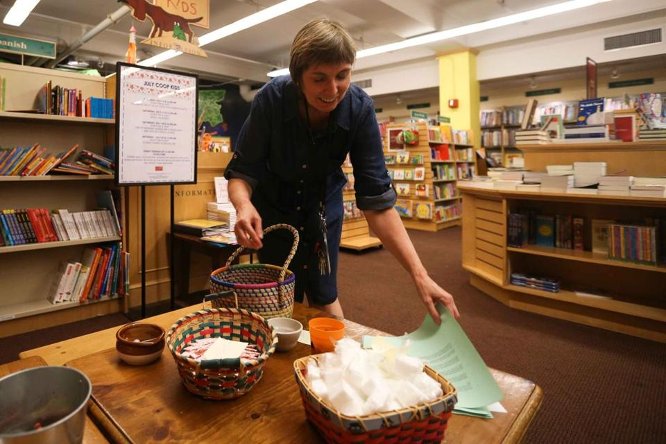 "Nancie Scheirer organized items for a scavenger hunt related to the release of Harper Lee's new novel, ""Go Set a Watchman,"" Monday at the Harvard Coop bookstore"