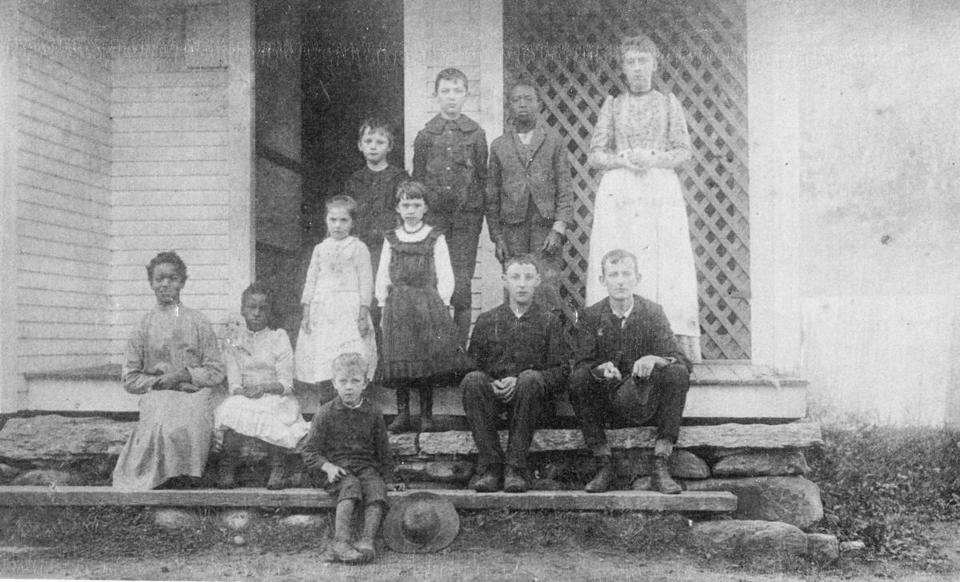 Sisters Susie and Daisy Turner (in the second row), and Susie's twin, Will (back row), circa 1890 at Grafton District School No. 11.