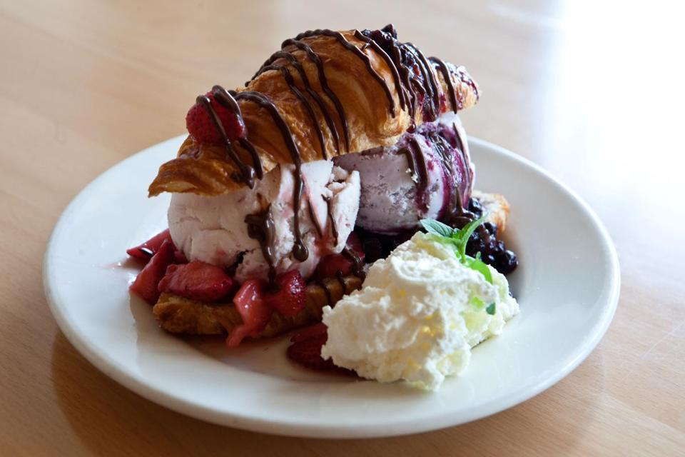 The Lobster Tail Sundae, served at New City Microcreamery, is made with a croissant, two scoops of ice cream, hot fudge, whipped cream, and berries.
