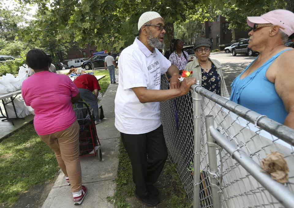 Imam Abdullah Faaruuq greeted residents waiting in line at his Roxbury mosque for the monthly food distribution program.