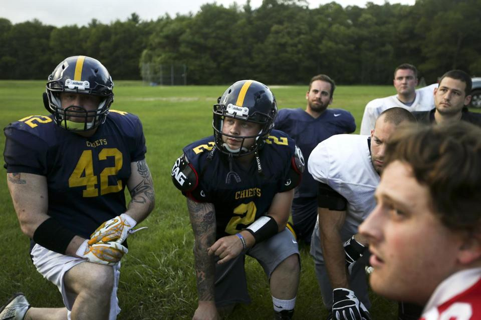 Members of the South Shore Chiefs semipro football team huddle up before their practice behind Center Elementary School in Hanover.