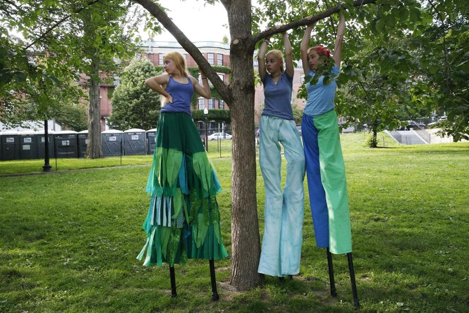 The Tremblay sisters and Diers used a tree for support as they waited to march in the parade.