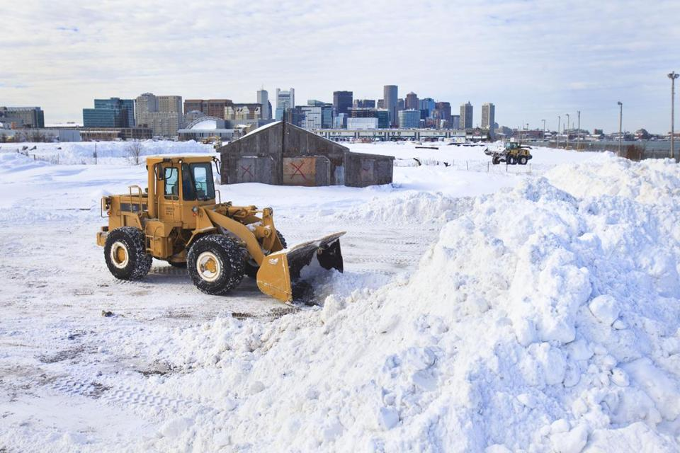 "1/28/2015 - Boston, MA - This is a ""Snow Farm,"" on Tide Street in South Boston where snow that has been removed from Boston roadways and sidewalks gets dumped. Boston Mayor Marty Walsh, cq, explained that crews were removing large snow piles and dumping it in snow farms such as this one. Photo by Dina Rudick/Globe Staff."