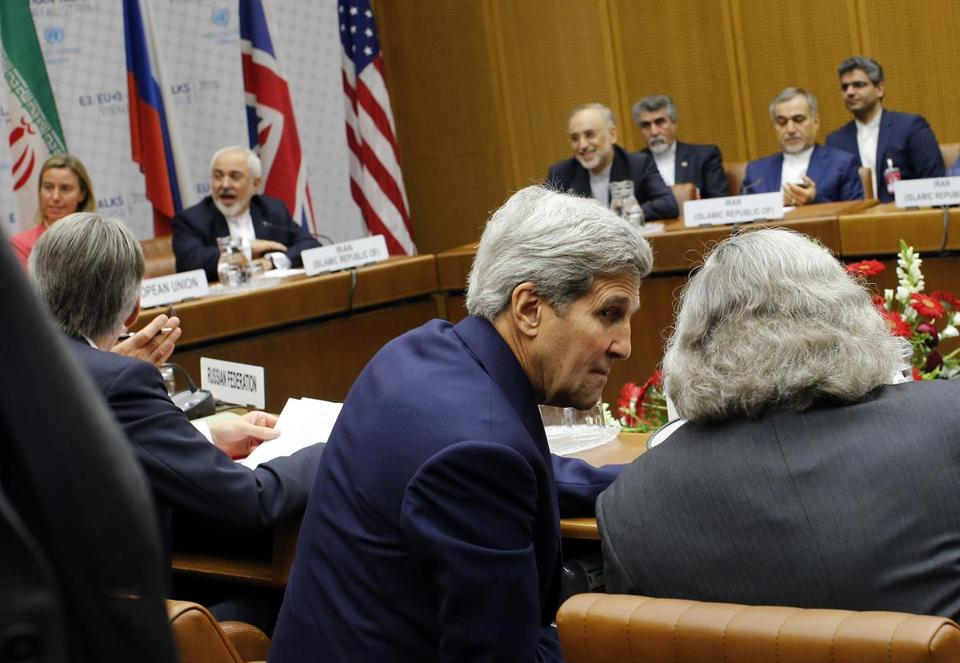 Secretary of State John Kerry conferred with Ernest Moniz, right, the secretary of energy, during talks in Vienna on Tuesday.