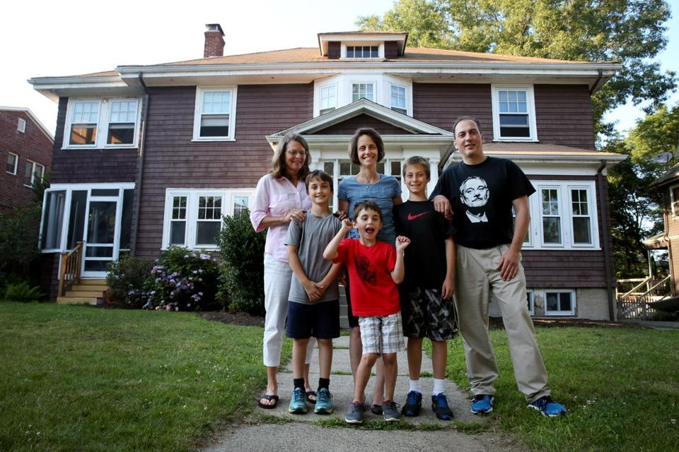 Norton (back row, center) lives in ther childhood home with her husband and three children. Two are shown here: Wyatt, 7 (left), and Will, 10. They bought the home from Emily's mother (back row, left).