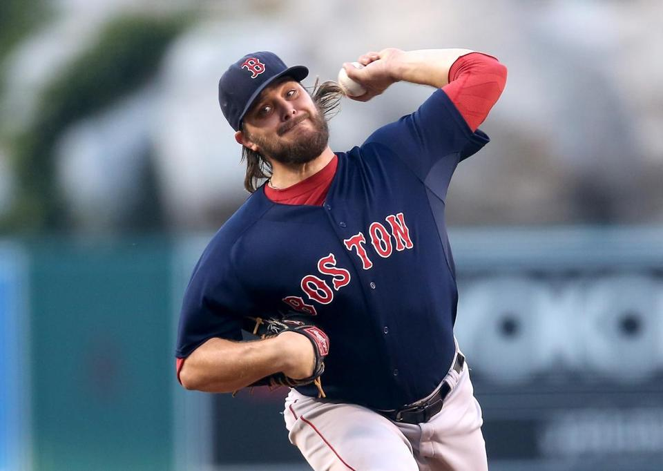 ANAHEIM, CA - JULY 17: Wade Miley #20 of the Boston Red Sox throws a pitch against the Los Angeles Angels of Anaheim at Angel Stadium of Anaheim on July 17, 2015 in Anaheim, California. (Photo by Stephen Dunn/Getty Images)