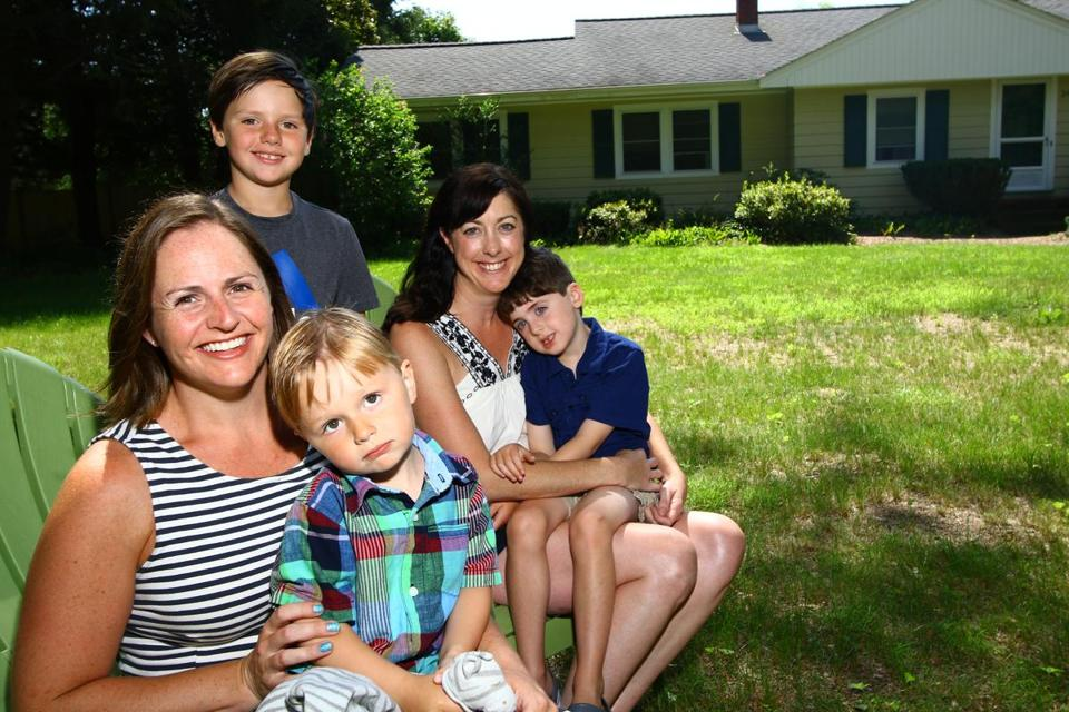 McKiernan and her kids, Oisin Barry, 3 and Aisling, 7, and her roommate and high school friend, Mary Larkin and her son, Patrick Quinlan, 4, at McKiernan's Boxborough home.