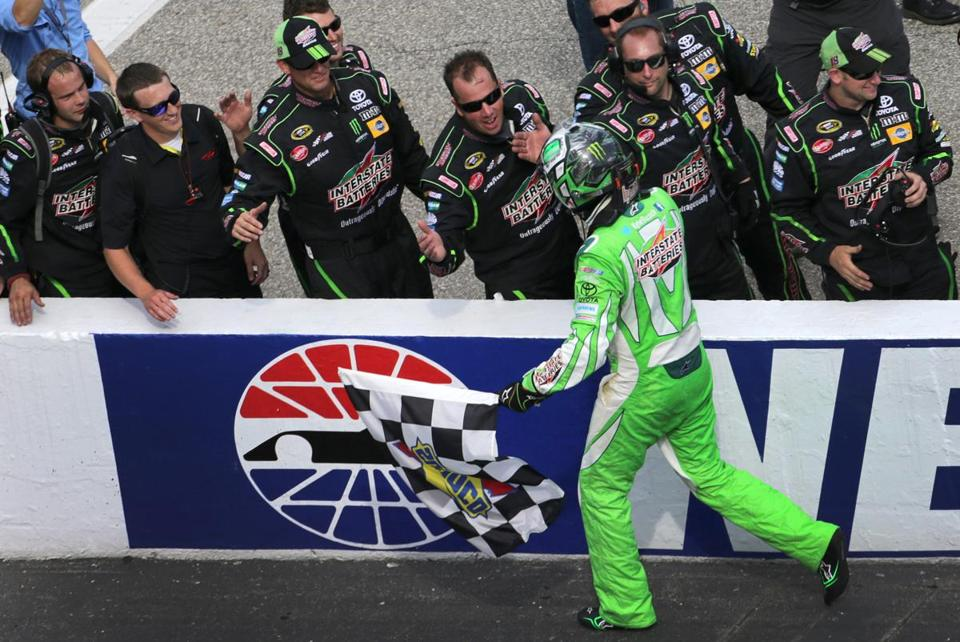 Kyle Busch celebrated with his pit crew after winning Sunday's race. The victory pulled him within 58 points of 30th in the Sprint Cup standings.