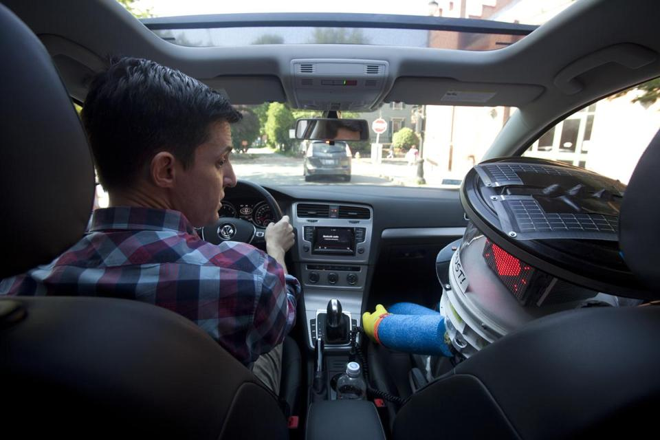 In Salem recently, the author and hitchBOT exchange anecdotes about their lives on the road.