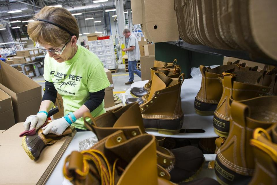 Alex Forest inspected and shined boots before packaging them at the factory in Brunswick, Maine.