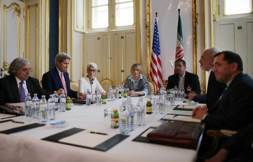 From left: Ernest Moniz, Secretary of State John Kerry, and Undersecretary for Political Affairs Wendy Sherman meet with Iranian Foreign Minister Mohammad Javad Zarif (second from right) and his delegation in Vienna in June.