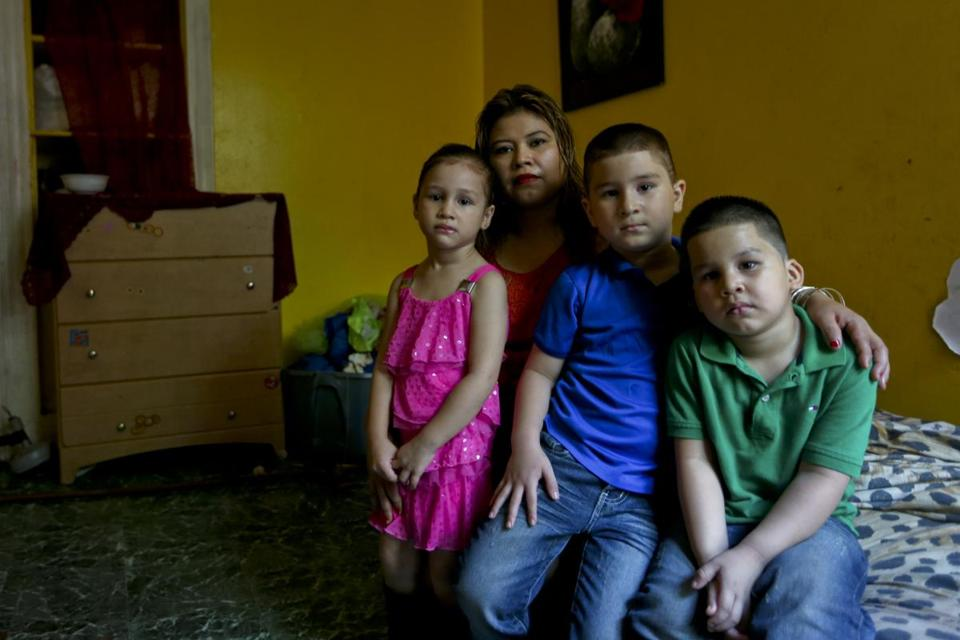 Glendy Garcia posed in her home with her children Shelsea, Jose, and William. Shelsea and Jose had been diagnosed with lead poisoning.