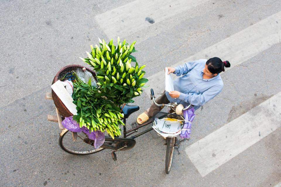 A flower vendor in Hanoi, a destination with some historical appeal for baby boomers.