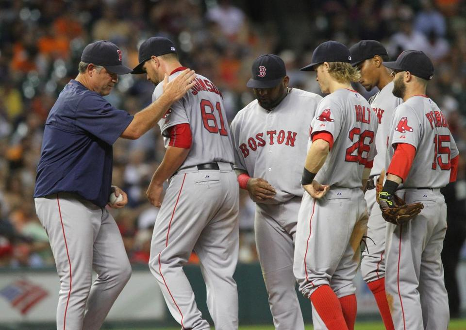 Red Sox pitcher Brian Johnson was pulled by manager John Farrell after giving up two runs to the Astros in the fifth inning on Tuesday.