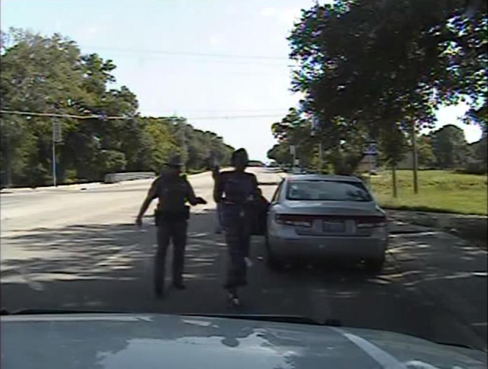 Texas state trooper Brian Encinia points a taser at Sandra Bland in a video still.
