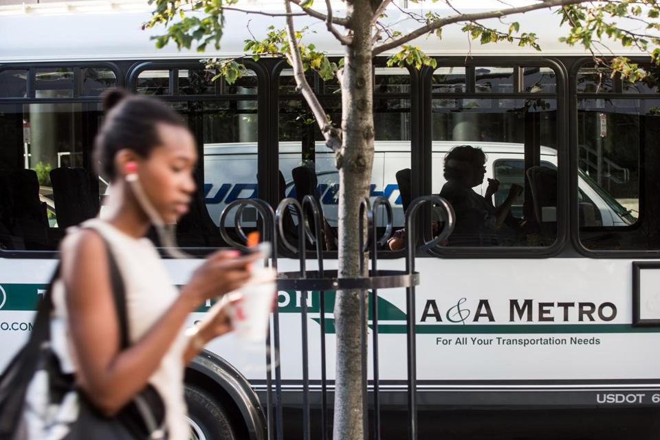 A single rider sat inside a private shuttle parked along Summer Street near the Federal Reserve building in Boston. Afar-reaching plan, funded by key waterfront firms, would consolidate 20 private shuttle routes into two bus routes to address traffic congestion in the area.