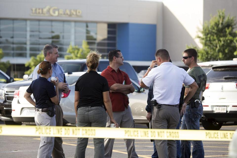 Investigators stood outside the movie theater on Friday where a man shot and killed two people and wounded nine in Lafayette, Louisiana.