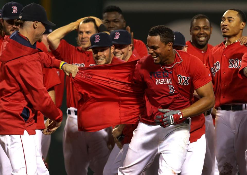 Xander Bogaerts was about to lose his shirt as Red Sox teammates celebrated his walkoff single in the 11th inning.