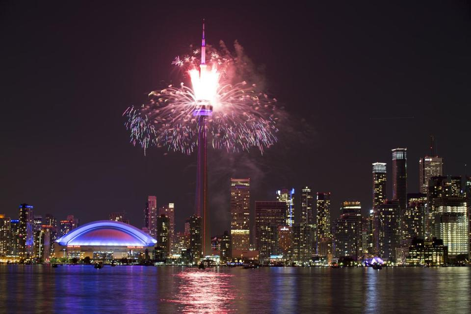 Fireworks exploded from the CN Tower over downtown Toronto during the closing ceremonies of the Pan Am Games Sunday.