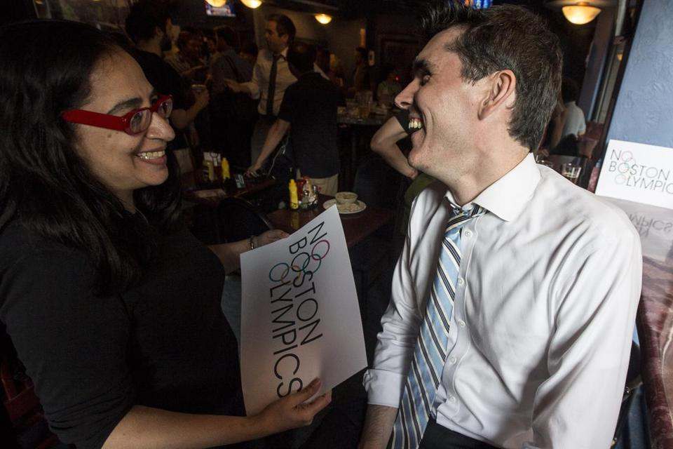 Chris Dempsey (right), a cochair of No Boston Olympics, laughed with supporter Radhika Bagai during a celebration after the city withdrew its bid.