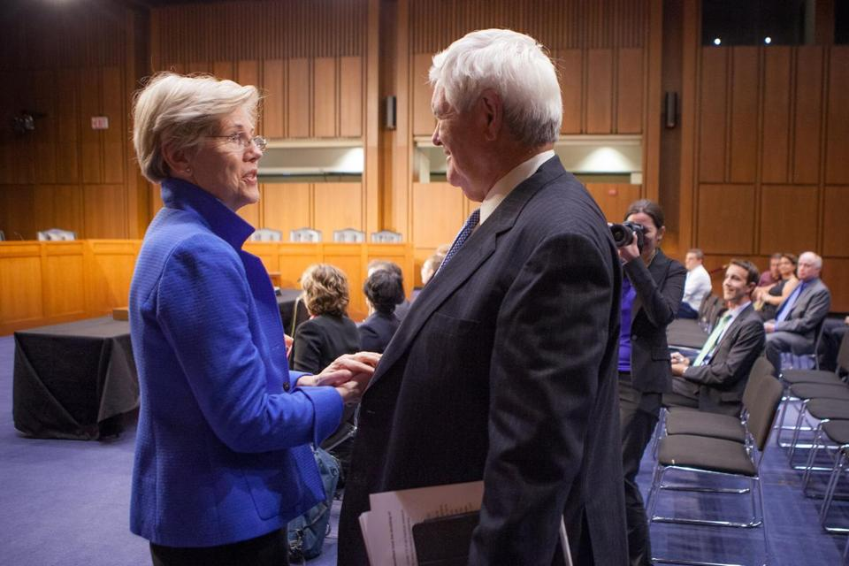 Senator Elizabeth Warren greeted former House Speaker Newt Gingrich before Monday's forum.